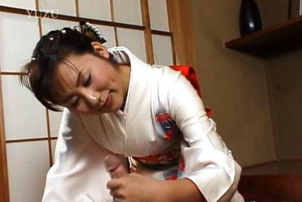 Kimono clad Japanese MILF Megumi Tsuchida wanks off a dick