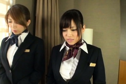 Gorgeous Japanese stewardesses please their horny boss