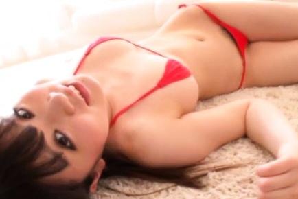 Alluring Japanese girl in red bikini looks so sexy eating ice-cream
