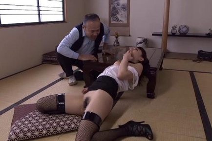 Hot Asian milf in fancy black stockings gives a cute double blowjob